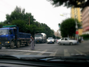 Photo: These are not the best pictures, but I think they give some sense of daily life in Urumqi... This woman is most likely Uighur.