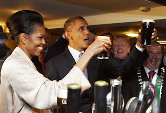 Photo: US President Barack Obama (2ndL) and First Lady Michelle Obama (L) sip Guinness at a pub as they visit Moneygall village in rural County Offaly, Ireland, where his great-great-great grandfather Falmouth Kearney hailed from, on May 23, 2011. Obama landed in Ireland on May 23, 2011 for a visit celebrating his ancestral roots, kicking off a four-nation European tour.    AFP PHOTO/ JEWEL SAMAD (Photo credit should read JEWEL SAMAD/AFP/Getty Images)