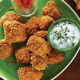 Baked Buffalo Chicken Tenders with Blue Cheese Sauce.