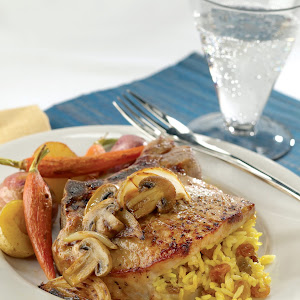 Curried Raisin Rice Stuffed Pork Rib Chops with Caramelized Onions and Mushrooms