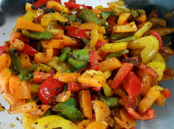 While meat is cooking slice bell peppers and cut into same size as you...