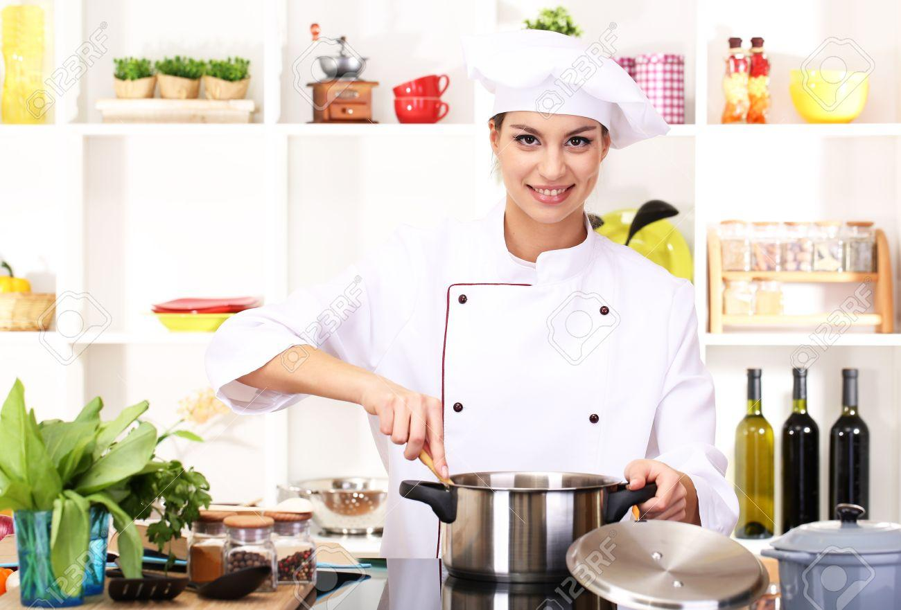 C:\Users\anin\Downloads\21537465-young-woman-chef-cooking-in-kitchen-min.jpg