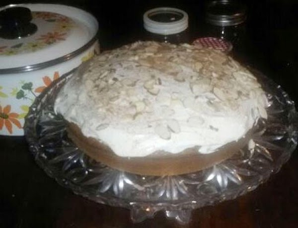 Frost just the top of a completely cooled cake. Using all frosting. Top with...