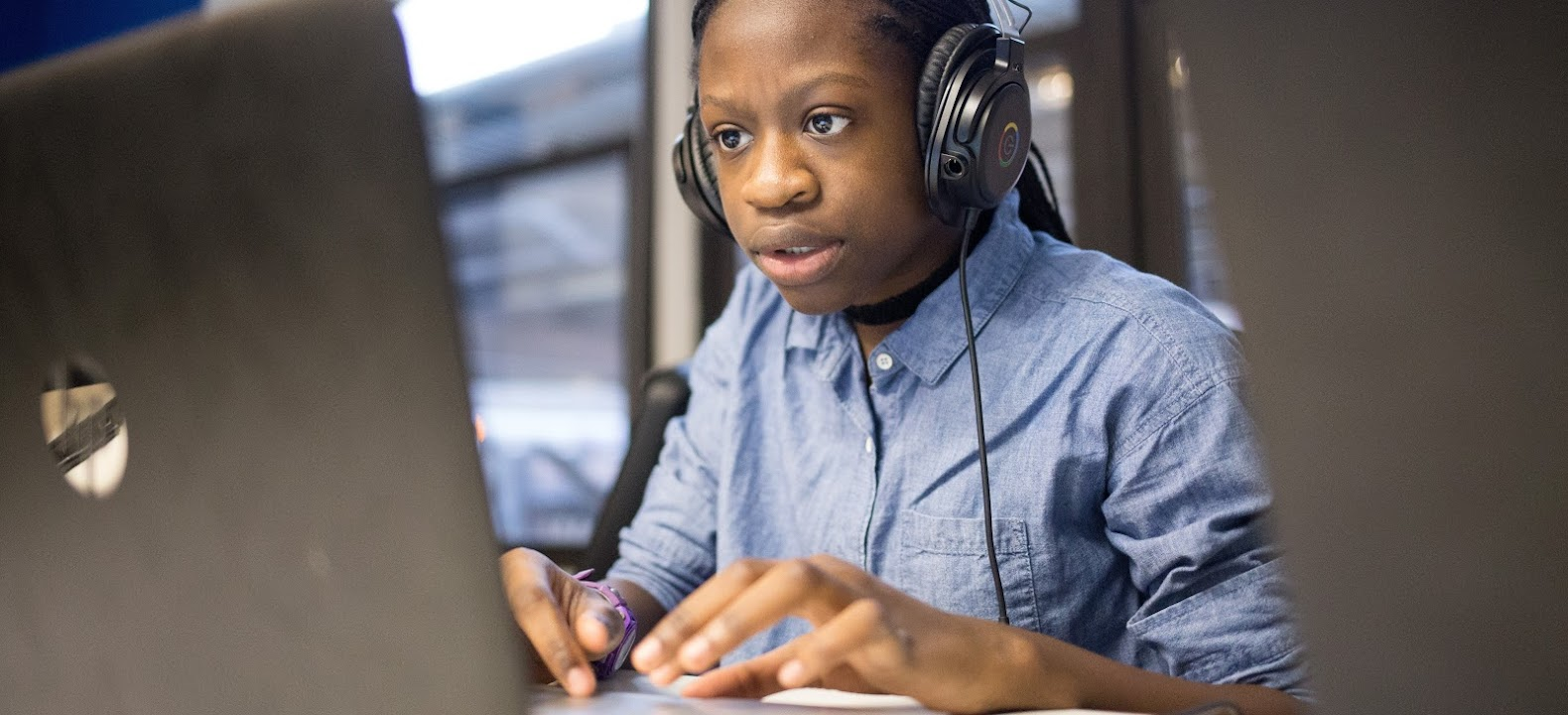 Black female student engages with technology.