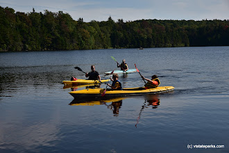 Photo: A group of kayakers glide over the water at Woodford State Park by Bill Steele