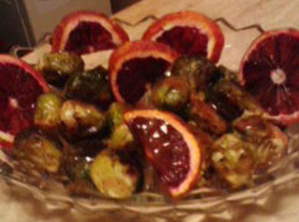 Remove brussel sprouts, plate, and drizzel with sauce, garnish with orange slices.