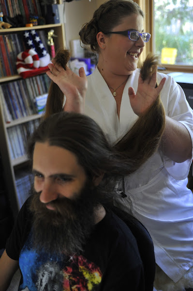 Photo: Kelly plays with Trevor's hair