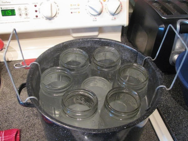 Prepare waterbath canner by placing clean jars on rack and fill pot and jars...