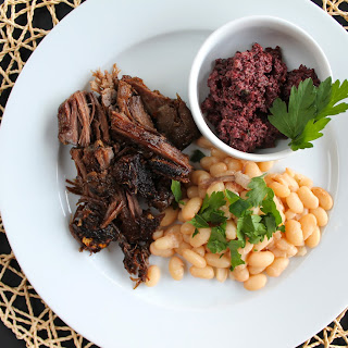 Slow-Roasted Lamb Shoulder with White Beans and Olive Tapenade