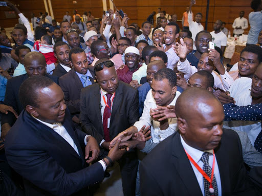 President Uhuru Kenyatta shakes hands with Kenyans who work and study in Sudan during a meet and greet session at the Corinthia Hotel, Khartoum, on Sunday, October 30, 2017. /PSCU