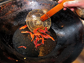 Photo: frying dried Thai chillies for the bitter melon salad