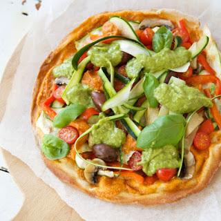Vegan Pizza with Tomato Cashew Cream and Avocado Herb Sauce.