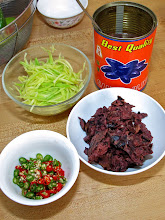 Photo: pitted salted black olives, julienned green mango and cut-up Thai chillies