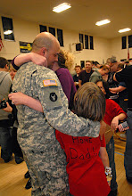 Photo: The third wave of 34th Military Police Company Soldiers returned to Stillwater, Minn. following their one-year deployment to Iraq.  The group of approximately 40 Soldiers arrived at 8 p.m. Feb. 5.