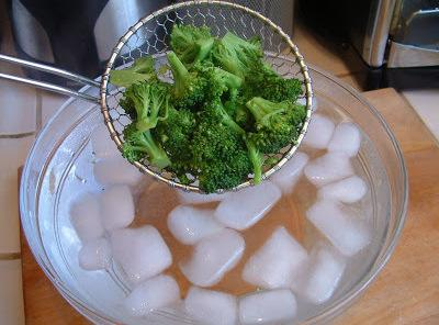 Stem your broccoli and then put in cold water bath to keep the bright...