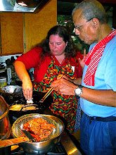 Photo: Becky dropping taro mixture into hot oil while Bill fries