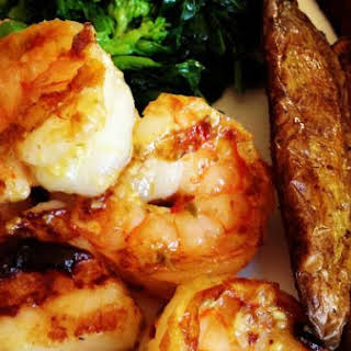 Grilled Shrimp & Scallops with Garlicky Pesto Butter.