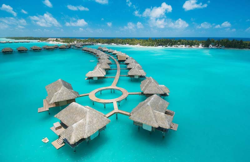Overwater bungalows at the Four Seasons Bora Bora. Airline employees can often snag overwater bungalows in Bora Bora or Tahiti at lower rates than the general public.