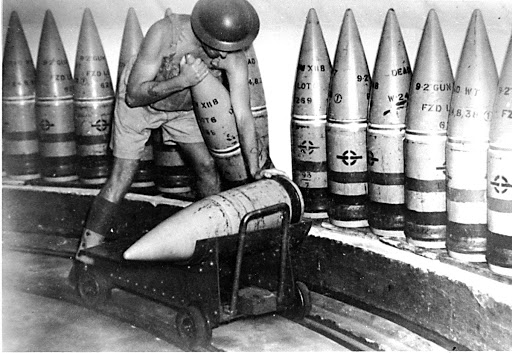Gunner loading a 9.2 inch shell on to a hand trolley at North Fort, North Head, Manly