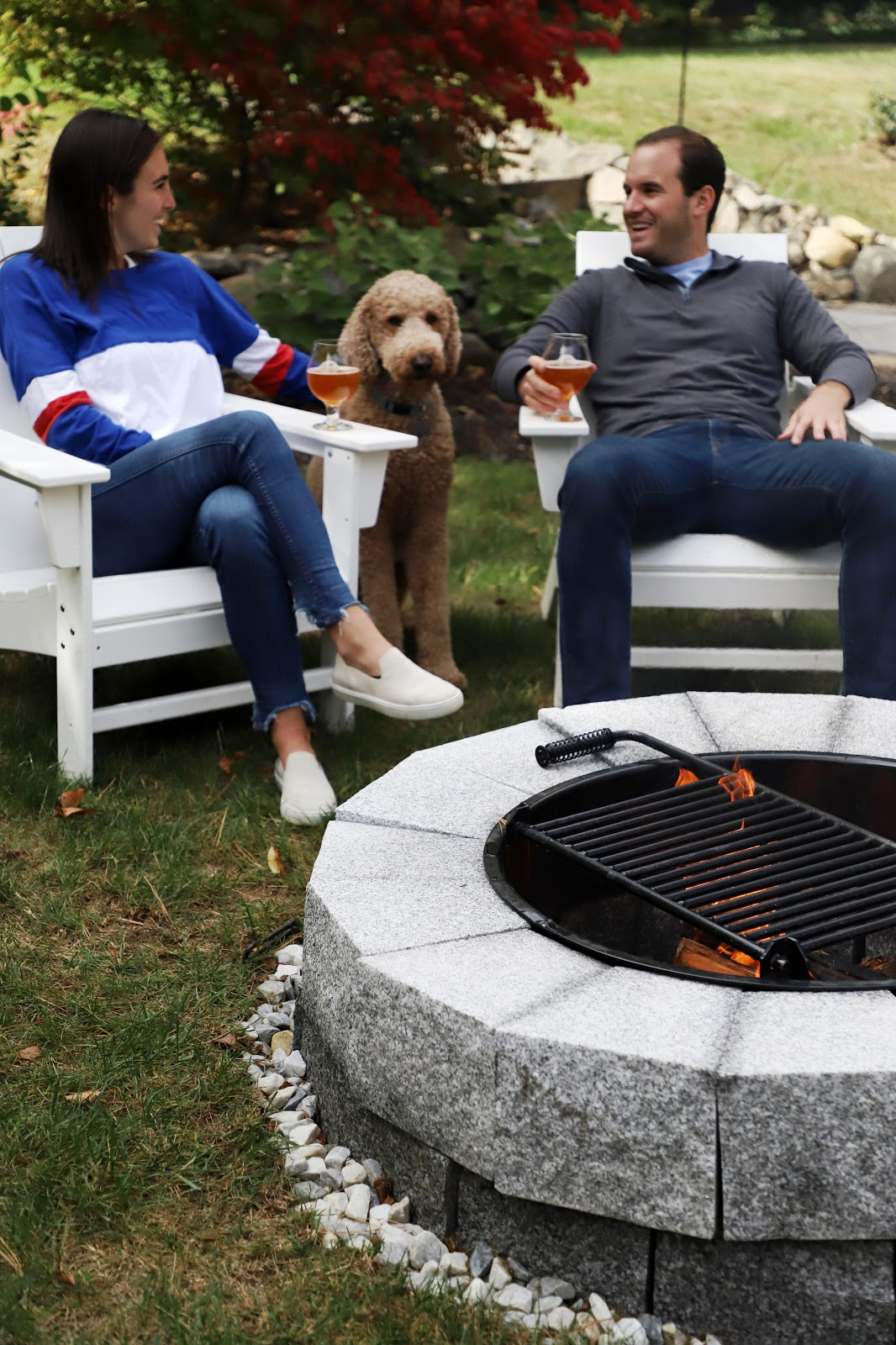 Couple by a Woodbury Gray granite DIY fire pit