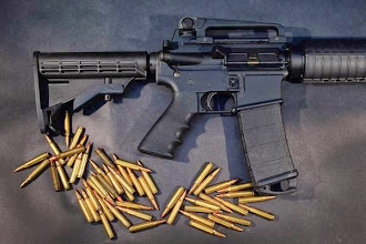 Photo: MIAMI, FL - DECEMBER 18:  In this photo illustration, a Rock River Arms AR-15 rifle is seen with ammunition on December 18, 2012 in Miami, Florida. The weapon is similar in style to the Bushmaster AR-15 rifle that was used during a massacre at an elementary school in Newtown, Connecticut. Firearm sales have surged recently as speculation of stricter gun laws and a re-instatement of the assault weapons ban following the mass shooting.  (Photo illustration by Joe Raedle/Getty Images) ** TCN OUT **