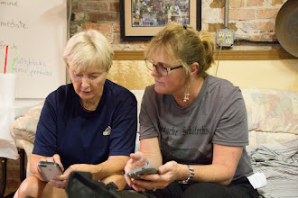 Photo: Terry and Carolyn compare phones