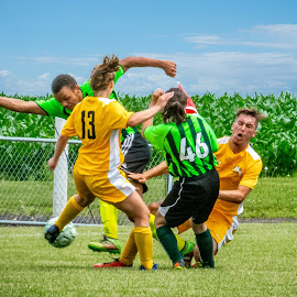 Going For The Ball by T Sco - Sports & Fitness Soccer/Association football ( play, ball, soccer, uniform, kick, field, players, fence, futbol, player )
