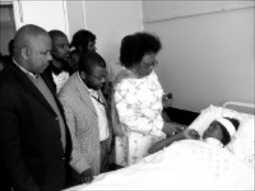 GET WELL: Eastern Cape transport MEC Thobile Mhlahlo, ANC chairman Zola Mlenzana and health MEC Nomsa Jajula visit patients after a bus accident in the province. Photo: Kamva Mokoena. © Sowetan.