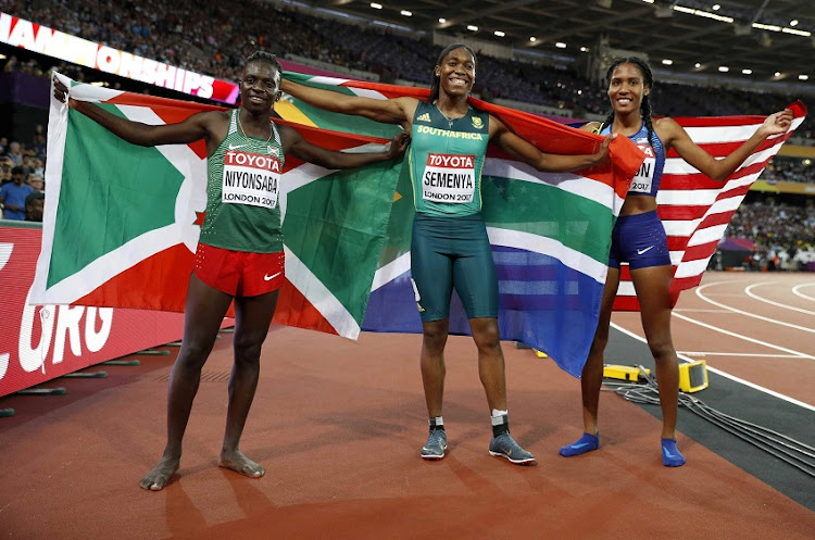 Ajee Wilson of the U.S. (bronze), Caster Semenya of South Africa (gold) and Francine Niyonsaba of Burundi (silver) celebrate winning medals.