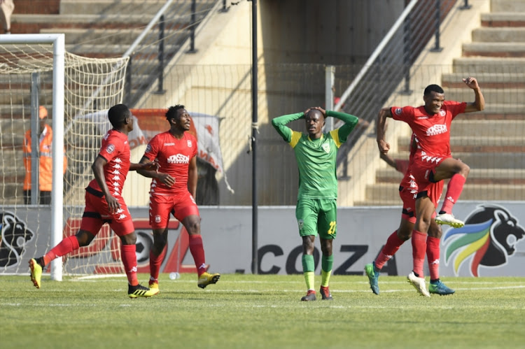 Mothobi Mvala of Highlands Park celebrates his goal with teammates during the Absa Premiership match between Highlands Park and Golden Arrows at Makhulong Stadium on September 16, 2018 in Johannesburg, South Africa.