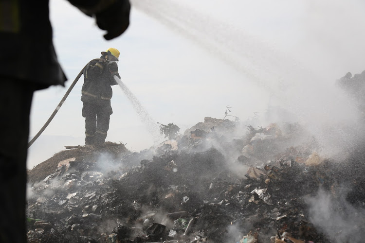 Firemen fighting the Msunduzi Landfill fire in Pietermaritzburg on Friday.