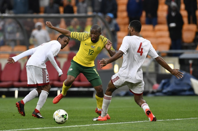 Nigel Nigel of Seychelles and Kamohelo Mokotjo of South Africa during the 2019 Africa Cup of Nations qualification match between South Africa and Seychelles at FNB Stadium on October 13, 2018 in Johannesburg, South Africa.
