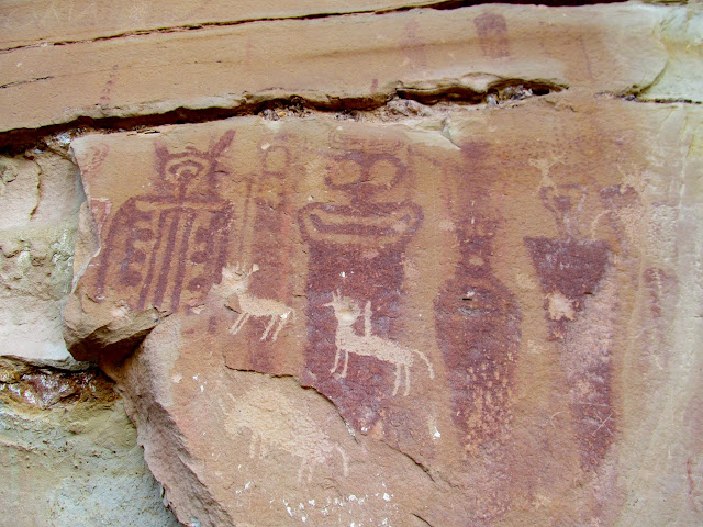 Barrier Canyon style pictographs overlain with Ute petroglyphs