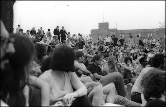 Photo: Students at a noon rally protesting the Vietnam War with school officials standing at the rear of the crowd.