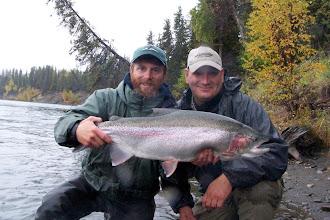 Photo: Jeremy Anderson of Alaska Drift Away Fishing holding Jerry Elmer's 30 inch rainbow trout.