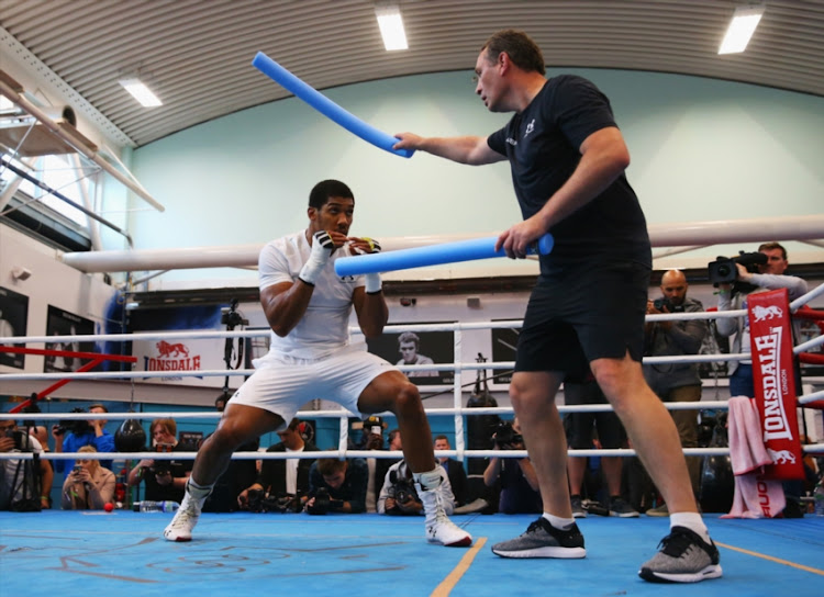 Anthony Joshua takes part in a training session with trainer Rob McCracken during the Anthony Joshua Media Day at English Institute of Sport on September 12, 2018 in Sheffield, England.