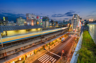 Photo: Ueno Burning Bright  Took this back in October at Ueno Station, but just now got around to processing it. I really enjoy the area around this station - lots of different scenery to enjoy as a photographer, and it's nice to have several good spots to shoot the station from as well.  Blog post: http://lestaylorphoto.com/ueno-burning-bright/