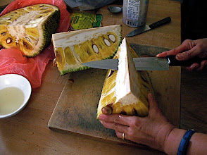 Photo: cutting core off jackfruit with oiled knife