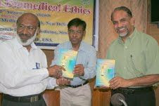 Photo: Prof PK Abdul Azis and Prof. YK Gupta releasing the book of Dr. Abdul Latif on Ethics