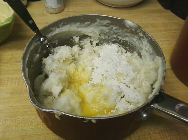 Beat egg into potatoes, along with 2 tsp. flour (if needed). Divide potatoes to...