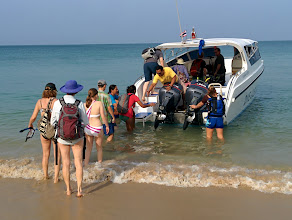 """Photo: A highlight of going to Thailand was an all-day snorkling trip from Koh Lanta to the uninhabited island of Koh Haa. Here the speedboat from """"Dive & Relax"""" picks us up at the beach."""