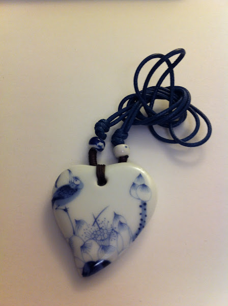 "Photo: Heart-shaped pendant with lotus & kingfisher. This belongs to blue and white porcelain. You can Wikipedia ""blue and white porcelain"" in google."