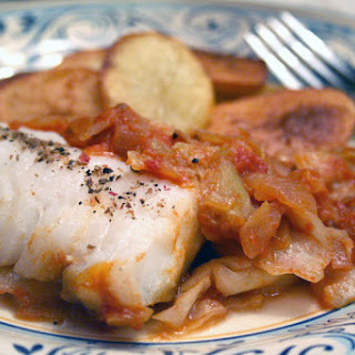 Steamed Cod with Cabbage in a Spanish Tomato Sauce and Fried Potatoes.