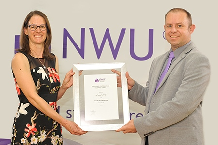 Dr Teresa Hattingh receives her reward from Prof Marco Le Roux, director of the Centre for Engineering Education.