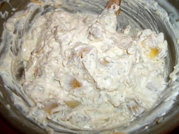 Add the Parmesan cheese and well drained Artichokes. Add pepper flakes now, if using...