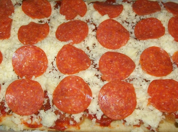Put another layer of the {unbaked pepperoni } on top of the cheese.