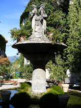 "Photo: The fountain on the small village square (called by the diminutive ""placette"") is topped by two statues, representing agriculture and abundance through industry. It's the work of the Apt sculptor Joseph Sollier, a pupil of the renowned David d'Angers (1788-1856)."