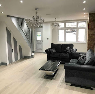 a recently renovated loft with wooden flooring