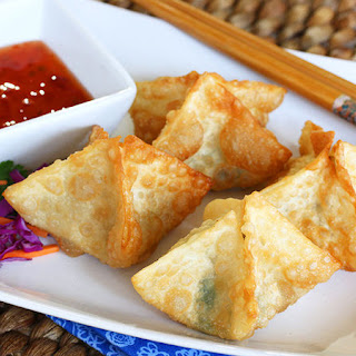 Goat Cheese and Bacon Wontons with Dipping Sauce.
