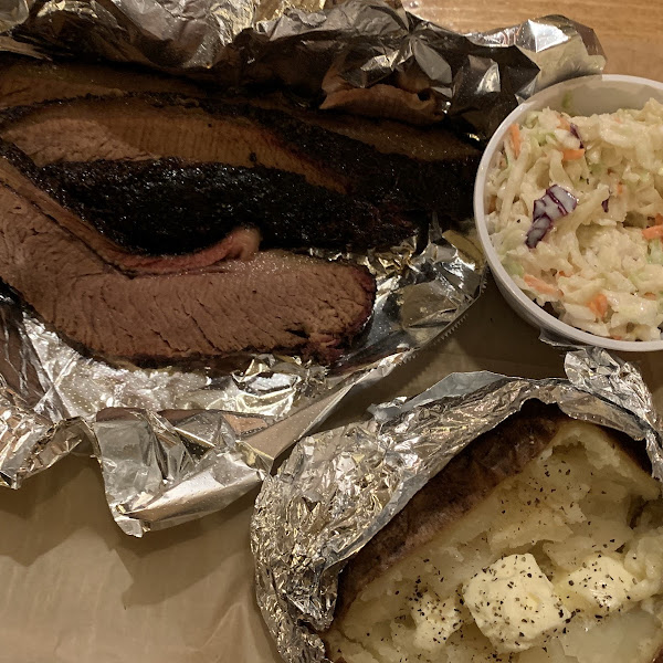 Beef brisket with foil for protection